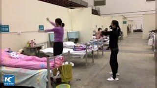 Coronavirus patients dancing at makeshift hospital in Wuhan, China