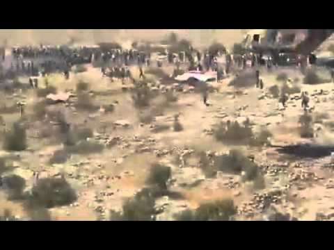 Iraqi helicopters delivering humanitarian aids to yazidies trapped in sinjar mountain