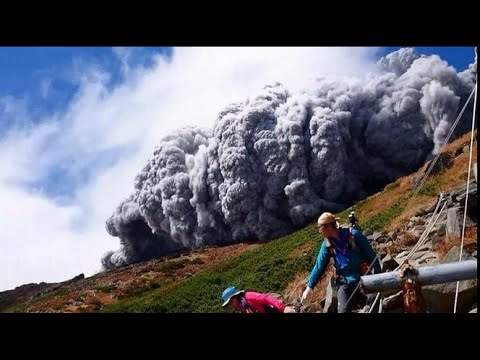 Japan's Mount Ontake volcano erupted/eruption, killing 34 people, report BBC (corrected aspect)