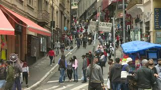 Sao Paulo streets busy as Brazil's virus death toll surpasses 90,000 | AFP
