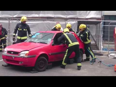 Firefighters rescue people from a car incident (exercise)