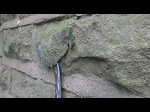Cement pointing damages stone - perfect example