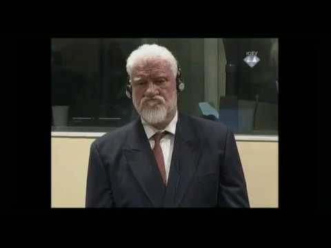 Bosnian-Croat war crimes suspect Slobodan Praljak 'takes poison' in UN court