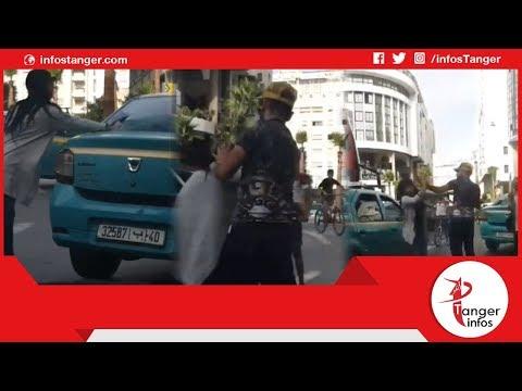 صادم.. لحظة تبادل الضرب بين سائق طاكسي و فتاة بالشارع العام بطنجة