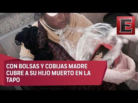 Imágenes desgarradoras: Mujer cubre a su hijo muerto con bolsas y cobijas