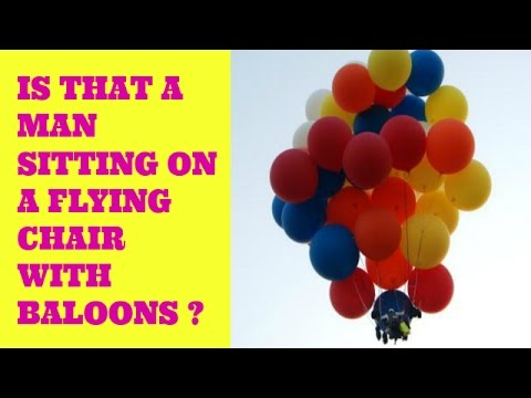 Man Flying in Lawn Chair With Helium Balloons.