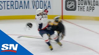 Alexander Ovechkin Sends Brad Marchand Flying With Massive Crunch
