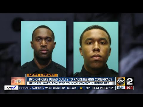 Two Baltimore police detectives plead guilty to armed robberies in racketeering case
