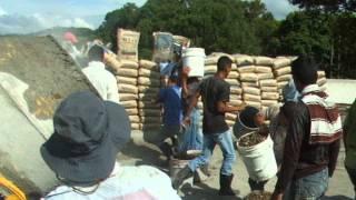 Mixing Concrete At The Bridge Construction Project At Las Flores Lempira, Honduras