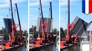 Dozens injured after two cranes collapse on top of buildings in the Netherlands - TomoNews