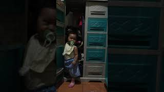 Baby trying to get in the Cabinet