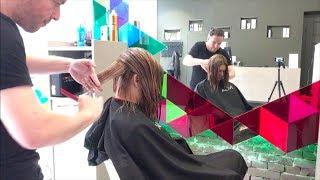 A graduated bob haircut with undercut