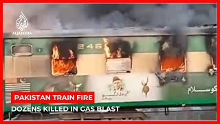 Dozens killed in gas canister fire on Pakistan train
