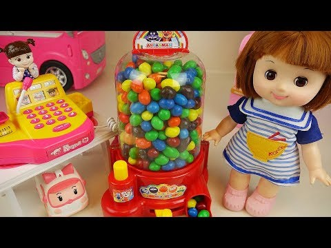 Thumbnail: Candy dispenser and Mart Baby doll surprise eggs toys play