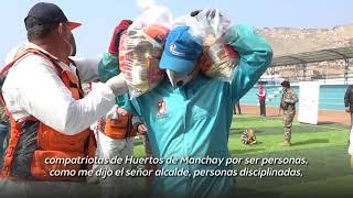 Entrega de canastas en Pachacámac