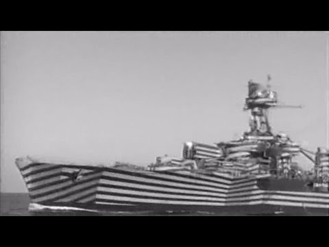 "French cruiser ""Gloire"" in dazzle camouflage firing guns - 1944"