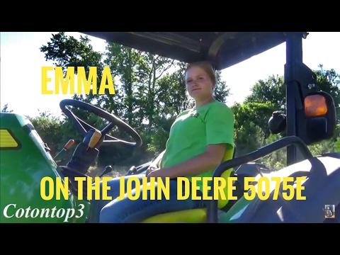 Teaching Emma how to run the John Deere 5075E tractor