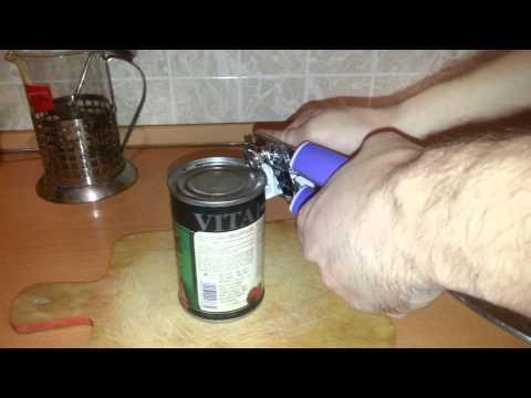 Как открыть консервную банку открывалкой с колесиком видео