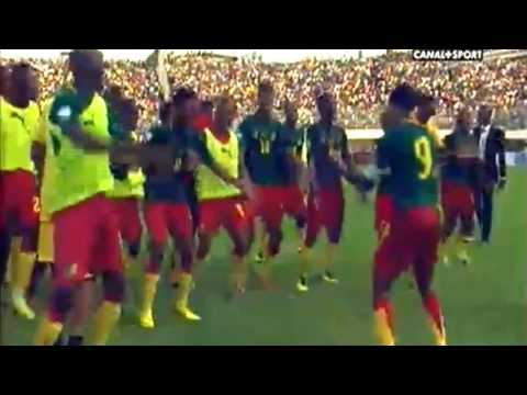 Cameroon's players dance after qualifying for  World Cup 2014