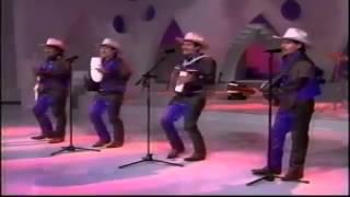 Dancing 'La Del Moño Colorado.' This is old school, but it's fun!