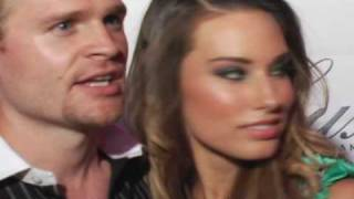 Adam Powell and Lauren Elaine attend the red carpet Siren Collection Runway Event in Hollywood