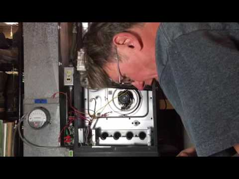 Cleaning burners on a mid-efficiency gas fired, forced air furnace