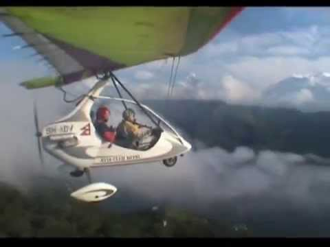 Two microlights taking off Pokhara airport and flying over Tibetan plateau