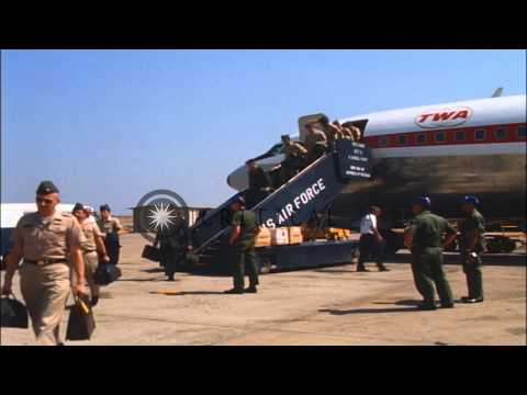 Officers, airmen and soldiers get off from a TWA jet at Bien Hoa Air Base in Viet...HD Stock Footage