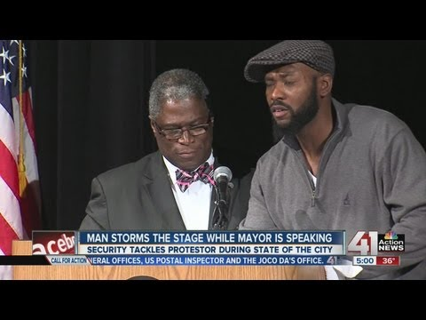 Man jumps on stage during State of the City address in Kansas City, Mo.