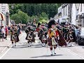 The Highlanders Pipes & Drums lead the Queen's Guard of Honour through Ballater to barracks Aug 2018