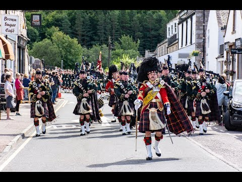 The Highlanders Pipes & Drums lead the Queens Honour Guard through Ballater to barracks Aug 2018