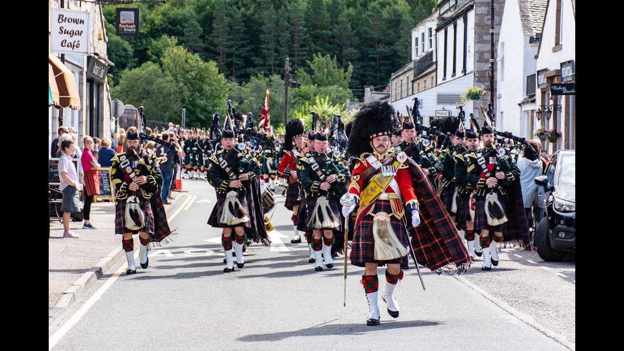 Download The Highlanders Pipes & Drums lead the Queen's Guard of Honour through Ballater to barracks Aug 2018