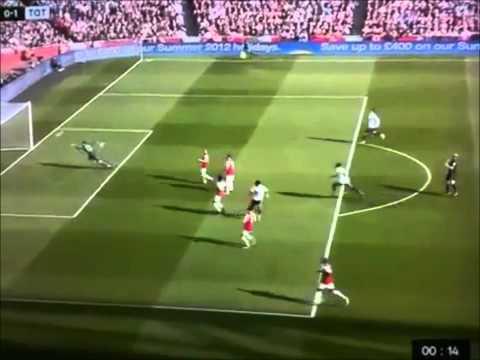 Referee Mike Dean celebrating Tottenham goal vs Arsenal