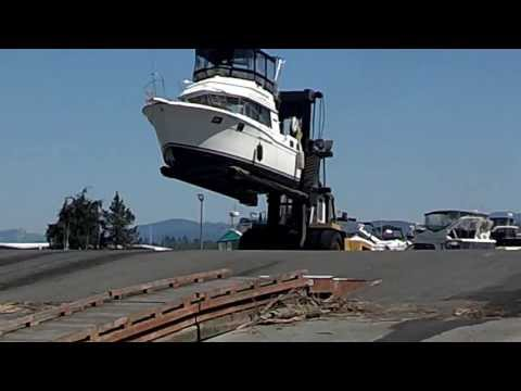 32 Carver boat pulled out of water by forklift