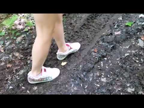 Girl new out of the box DC shoes trashing supper muddy and wet trail