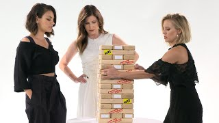Kristen Bell & the cast of A Bad Moms Christmas play Truth or Dare Jenga