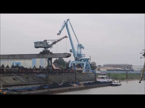 A day with port crane Coal unload from ship with time lapse