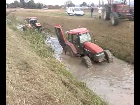 new holland m 100 coulé + puma 140 - YouTube