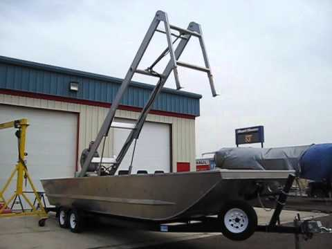 Where can someone find a work barge for sale?