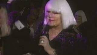 Miss Peggy Lee singing to her friend