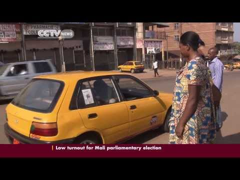 A ride in Cameroon's taxi-buses: Yellow & black cars dominate the public transport industry