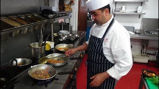 Busy Chef at Work: Action Inside an Indian Restaurant Kitchen at Bradford Zouk Tea Bar & Grill, U.K.