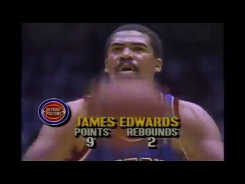 James Edwards Dunks Over Two Lakers at Once