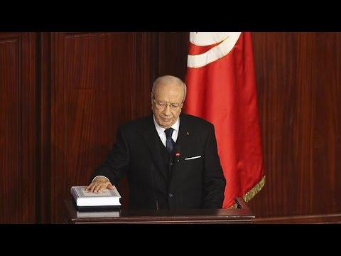 Tunisian President Beji Caid Essebsi pledges reconciliation as he is sworn in