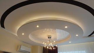 Установка круглых черно-белых натяжных потолков
