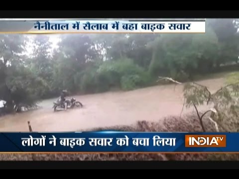 Biker get swept in flood in Nanital