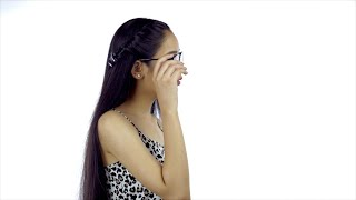 Slow-motion shot of a beautiful Indian girl removing spectacles and smiling