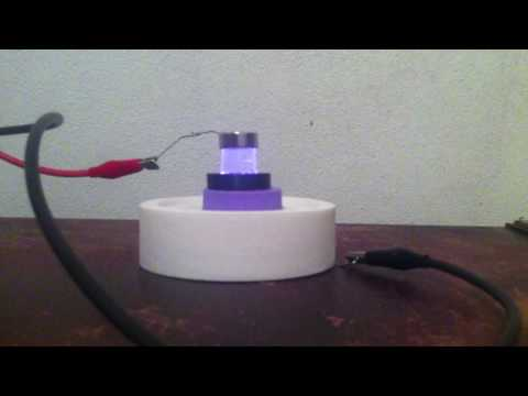 Quartz Tube Between Two Ring Magnets Creating A Rotating Plasma Arc