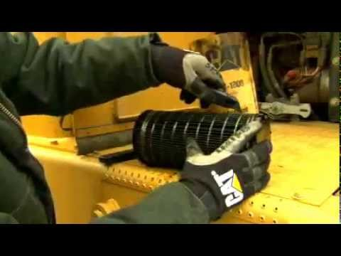 Cutting Open And Inspecting A Cat® Oil Filter