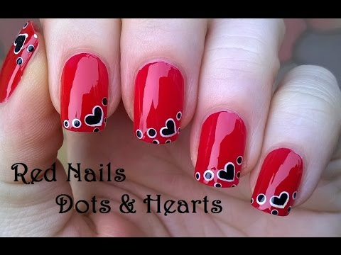 red nails with dot & heart nail
